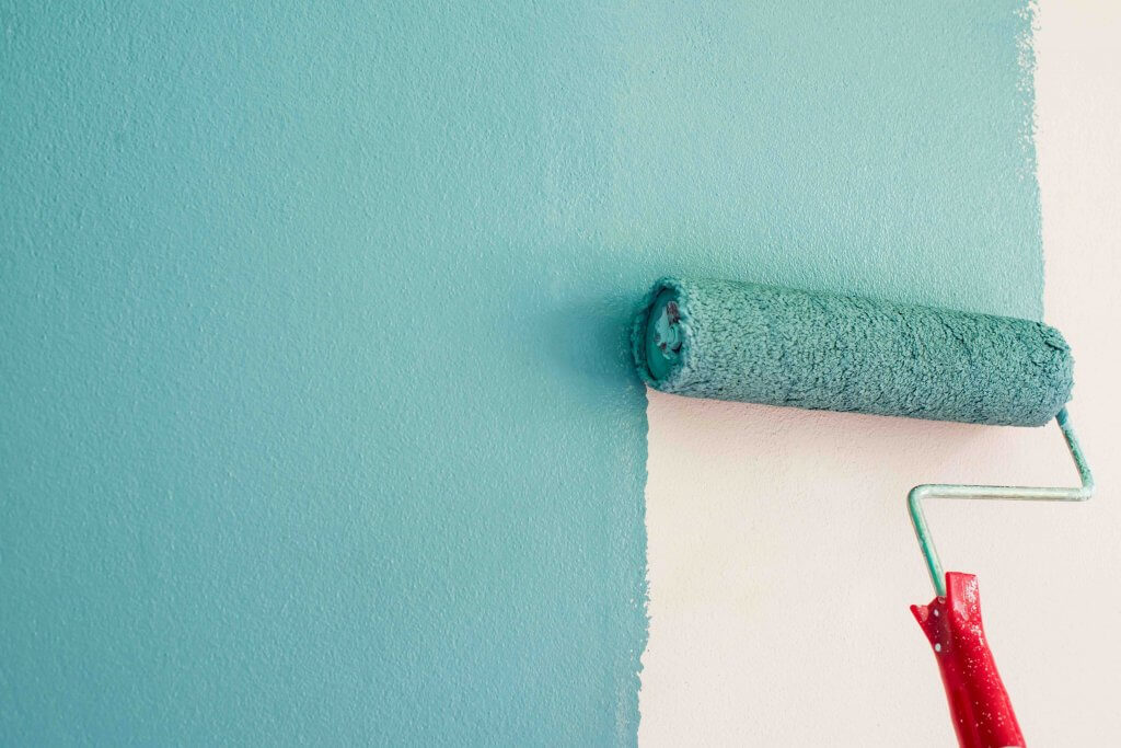 paint roller blue on wall